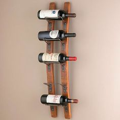Barrel Stave Wall Wine Rack - $99.95»  Wine bottles displayed on wine racks fashioned from barrel staves make for instant wall art.