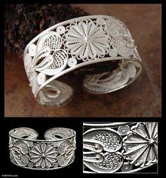 http://andes.novica.com/jewelry/bracelets/silver-filigree-bracelet-sunflower/167605/