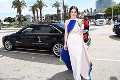 Downton Abbey actress and nominee Michelle Dockery in her multi-colored Rosie Assoulin gown at the 2014 Emmys http://dailym.ai/1lufdYb