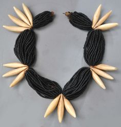Fijian necklace composed of imported seed beads in combination with whale ivory.  Necklaces like this were styled on western tastes and probably either commissioned for a special departure from traditional materials and or was designed for western consumption. Last quarter of the 19th c (archives sold Singkiang)