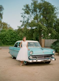 aqua vintage wedding car