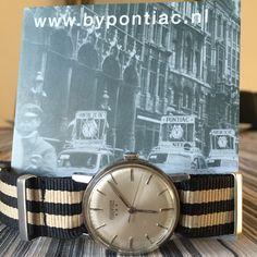 --- Pontiac 1957 met natoband ---