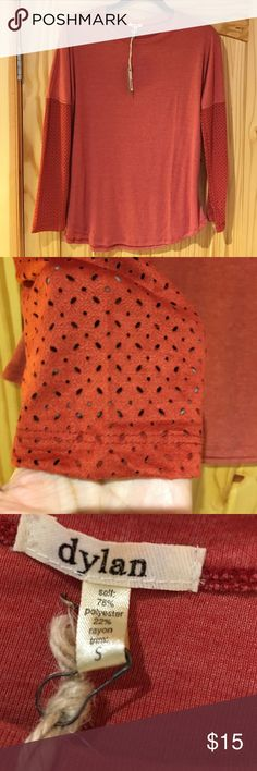"""Dylan small rust colored shirt w/fancy sleeves 🌺 The shirt is very soft. It is NWT. purchased for a gift but it did not fit my friend. It is 78% polyester, 22% rayon for the shirt then if I understand the label correctly it is 90% polyester, 10% spandex, for the trim. Machine wash gentle, tumble dry low.  From the bottom edge of the collar to the bottom of the sleeve is 26 1/2"""". There is no shoulder seam.  It's almost 20"""" across. It is 26 1/2"""" from the bottom of the collar to the bottom of…"""