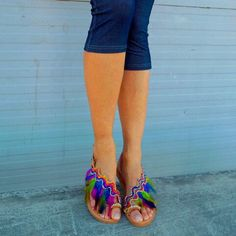 Obsessed with our new dazzling feather sandals 'Rainbow Macaw' 💜💛💚