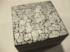 Take a look at this idea for using eggshells to create a distressed/raku effect on a wooden box.