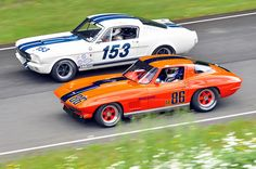 Corvette vs. Mustang... Now these two know how to enjoy a muscle car. Take it to the track and race it!!! Yeah Baby!!!