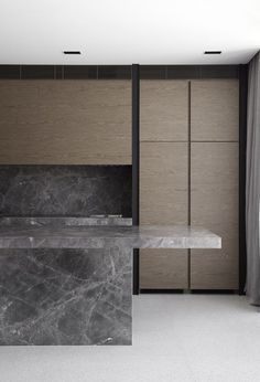 Very stickt modern but Lovely with wood and gray marble