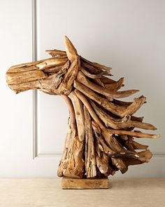 "$380 ""Horse"" Driftwood Sculpture  Breathe life into your decor with this bold horse head formed of found and reclaimed driftwood. Each handcrafted piece is unique and finds a perfect balance between rustic and refined. Handcrafted of found and reclaimed teak wood. For decorative use only. Approximately 12.5""W x 30""D x 32""T. All dimensions and weight are approximate as each sculpture is unique and crafted by hand. Boxed weight, approximately 30-35 lbs."
