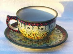 Cup with plate in warm colors, nice :) Polish pottery