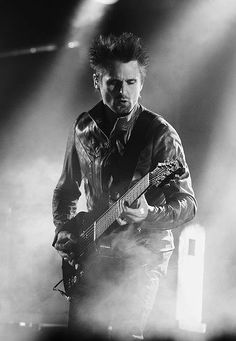 Matt Bellamy ❤ the fact that he does vocals and guitar. ridiculously talented. his voice is velvet.