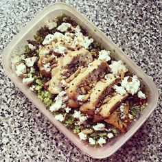 Lunchbox yumminess today with broccoli rice cooked with red onion, tomatoes and topped with crumbled feta and toasted seeds and a grilled garlic and herb chicken breast!