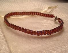 Beaded bracelet - red - handmade from quality Japanese seed beads. Includes cream organza gift bag. on Etsy, $9.95 AUD