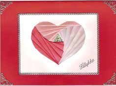 iris paper folding heart for card (or whatever).  I've never tried iris-paper folding before, looks pretty.