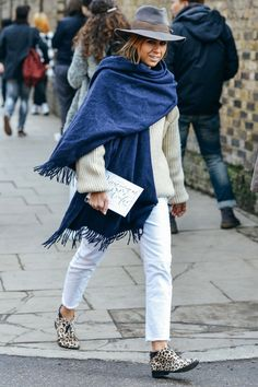 We love this large dark scarf combined with clear clothes and a hat to keep you warm!
