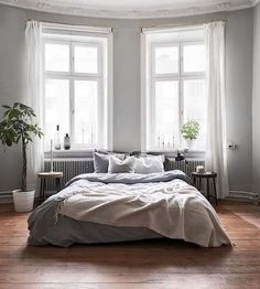 8 Dreamy And Cosy Grey Bedroom Ideas Grey is a deeply versatile, effortlessly stylish colour for a dreamy, cosy bedroom. Easily style your own with these 8 grey bedroom ideas. Cosy Grey Bedroom, Silver And Grey Bedroom, Silver Bedroom Decor, Farmhouse Bedroom Decor, Blue Bedroom, Rustic Farmhouse, Farmhouse Style, Home Interior, Interior Design