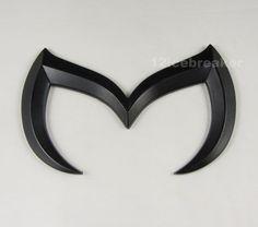 Custom Mazda emblem, metal finish and flat adhesive backing. $4.99! Cool...