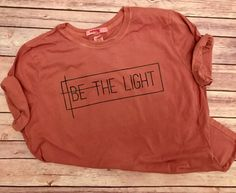 BE THE LIGHT //On Sale --Women's Christian Graphic Tee, Christian Shirts, Shine, Positivity, Cross, Faith TShirts, Give Them Jesus