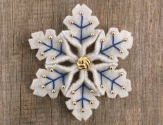 Snowflake Felt Pin Blue Gold Upcycled. $15.00, via Etsy.