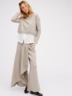 Sunday Set   A so-cozy cotton set with an effortless feel. Features a simple long sleeve crew neck top with a slight cropped, boxy shape. Bottoms feature an easy, flared shape with a wrapped overlay creating the look of a maxi skirt with the comfort of pants. Drawstring tie at the waist for a comfortable fit. Side pocket details.