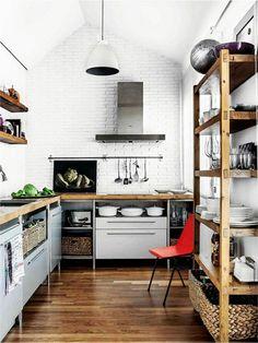 loft kitchen, open shelves, wood floors, wood countertops, white walls, hanging rod for utensils