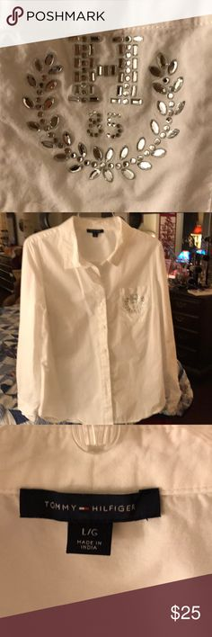 Tommy Hilfiger white shirt Buttons down the front. Sparkling rhinestones. Worn two times. Loss weight. Now too big. My loss your gain. Sleeves can be tied up to three quarter length. Clean. No marks. Tommy Hilfiger Tops Button Down Shirts