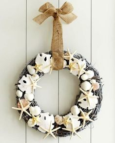 Festive coastal beach wreath made with resin starfish, sand dollars and shells: http://www.completely-coastal.com/2015/11/sea-inspired-coastal-christmas-collections.html
