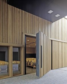 Image 9 of 30 from gallery of Winery Nals Margreid / Markus Scherer. Photograph by Bruno Klomfar Architecture Details, Interior Architecture, Interior Design, Winery Tasting Room, Timber Door, Entrance Design, Wooden Slats, New House Plans, Windows And Doors