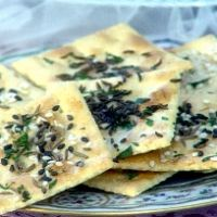 Easy Herbed Glazed Saltines.Preheat oven to 325. Brush crackers with melted butter then arrange on a baking sheet. Combine caraway, celery and sesame seeds and sprinkle over butter on crackers. Bake for 15 minutes then serve warm