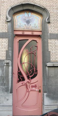 For the door people - ornate patterned door in wook and glass, pink - ish color, stained glass above, charming