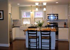 small white kitchen, fridge wall, range microwave
