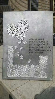 Buy a puzzle. Spray a solid color. Create your own message/design on top