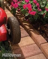 Image result for Bury stones to make a mow strip