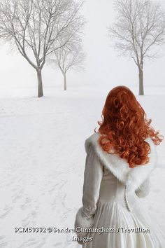 Trevillion Images - woman-in-white-dress-walking-in-snow