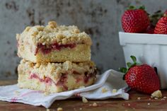 Strawberries and rhubarb combine with a crumb topping to create a delicious summer cake.