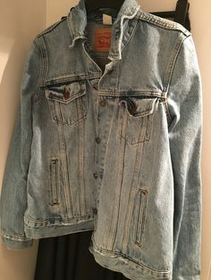 Black jeans and denim jacket for cozy weekends at home.