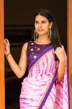 Chic back style alert! Bringing you cool pre-designed styles in blouses to suit every fancy. A sassy purple blouse with cool polka dot threadwork and a bottom tie back for added sass.Pair with any saree having purple detailing or pick any of the polka dot colors of orange, cream, peach or pale green…your imagination is the limit! #purple #rawsilk #polkadots #threadwork #blouse #India #saree #houseofblouse