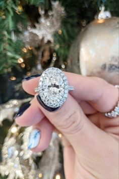 """This platinum halo engagement ring setting features a 5.02 carat oval center stone diamond and 1.31 carats of diamond accents along the halo and shank. The oval center stone is a VS2 in clarity and an """"I"""" in color. Available at Diamonds Direct. #platinum #engagementring #halo #oval #ovaldiamond #ovalcenter #5carat #bling #ring #jewelry #diamonds #diamond"""