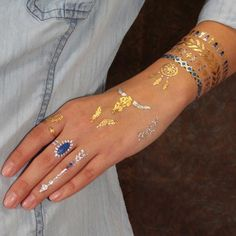 Temporary tattoos jewelry perfect for the oh-so-chic cowgirl. Rock your Southwest spirit with American Indian inspired metallic body jewelry. This tattoo set in