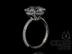 He'll never have to guess... I LOVE this setting! Solitaire engagement ring by Leon Mege