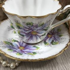 Rare 1940s Royal Stafford Dahlia English Tea Cup and Saucer Set ~ Rare and Lovely purple flowers on white Royal Stafford English tea set in excellent condition. ~ Mid-Century Fine Bone China Tea Cup & Saucer adorned with purple and violet Dahlias. ~ Beautiful gold gilt trim along