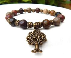 Simply gorgeous nature inspired tree bracelet made with 8mm River Jasper and a Antique Bronze Tree of Life Charm. River Jasper has beautiful colorful natural earth tones. River Jasper Properties: A st