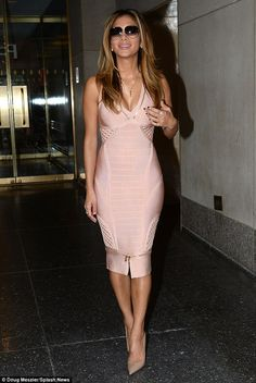 Latest appearance: Nicole Scherzinger showed off her curves in a form-fitting peach bodycon dress while making an exit from the Manhattan studies of popular chat show Today