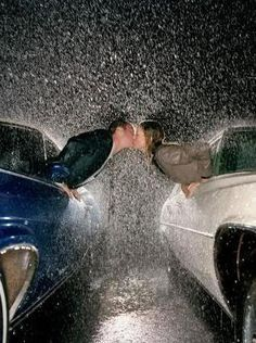 "kissing in the rain. cute idea for engagement/save the date photo. ""We're getting married, come rain or come shine"". Great idea for one getting married."