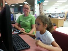 Asaya improves her reading skills, carefully pronouncing all the words in the game instructions with Megan's help.