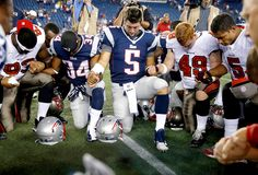 Tim Tebow and some teammates...and even some opposing team members! He is such an inspiration.