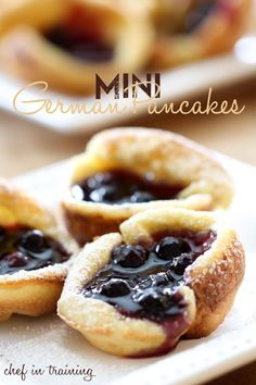 MINI GERMAN PANCAKES: Preheat oven to 400 F. Blend 6 eggs, 1c flour, 1c milk, 1/2tsp salt, 1tsp vanilla and 1/4c melted butter until smooth. Pour batter into greased muffin tins until each slot is filled 1/2 way. Bake for 15-18 minutes until puffed up. BLUEBERRY SAUCE: Cook 1c water, 1/2c sugar, 3/4tsp lemon juice, 1tsp vanilla and 2 1/2tbsp cornstarch in a saucepan over medium heat until it thickens. Stir in 1c blueberries and simmer for about 10 minutes. Fill pancakes with blueberry sauce.