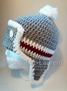 Hat theme: wool socks 2 buttons in front that holds the flap pilot 2 earmuffs mat: soft and padded (100% polyester)