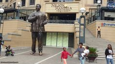 Nelson Mandela Square is a vibrant hub in the heart of Johannesburg's upmarket Sandton suburb in Gauteng province. The square is a great place to enjoy Johannesburg's vibrant urban spaces. Nelson Mandela, In The Heart, Great Places, Vibrant, Street View, Urban, Spaces