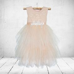 A dress made with veiling tulle & sparkly sequence materialwith lace detail on the waistline. The inner body of the dress is made from a soft,…