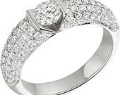 An eye catching dress diamond ring with shoulder stones in 18ct white gold